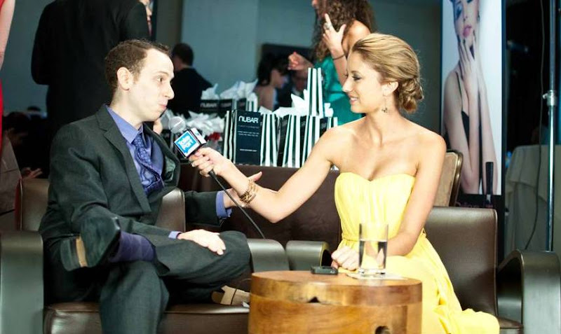 Photo: Josh Sussman of Glee gets interviewed by TakePart.com in the Alvar Aalto Bentwood Lounge Chairs! — at The Beverly Hilton.