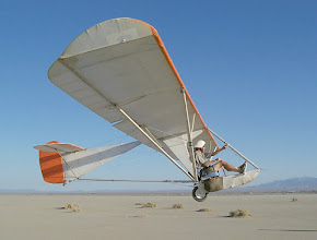 Photo: This could be an airchair at the start of a tow, but it isn't.  In a strong wind, on a static line, Floyd Fronius is just floating in place as I take this picture. This is the Goat1 on a tethered flight at El Mirage Dry Lake, near Palmdale, California, in July of 2004. This image provides a good idea of the maximium angle of attack of the aircraft, and provides a good view of the hand deployed emergency parachute mounted on the side of the nose below the pilot's seat