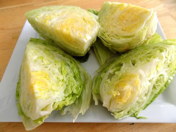 Rinse off a head of iceberg lettuce and remove the core and the outer...