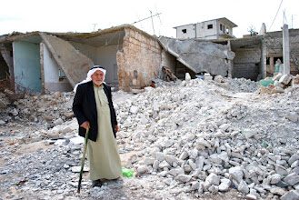 Photo: An elderly man stands by the ruins of his home after it was hit by a scud missile in Atareb, a small village located in the governate of Aleppo, Syria. The village has been under rebel control for nearly a year. Atareb, SYRIA - 30/3/2013. Credit: Ali Mustafa/SIPA Press