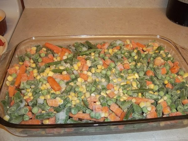 Add mixed vegetables and spread evenly over meat.