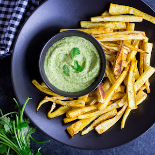 Curried Parsnip Fries with Cilantro Hummus Dip.
