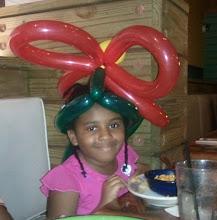 Photo: Kaleya wears her flower hat
