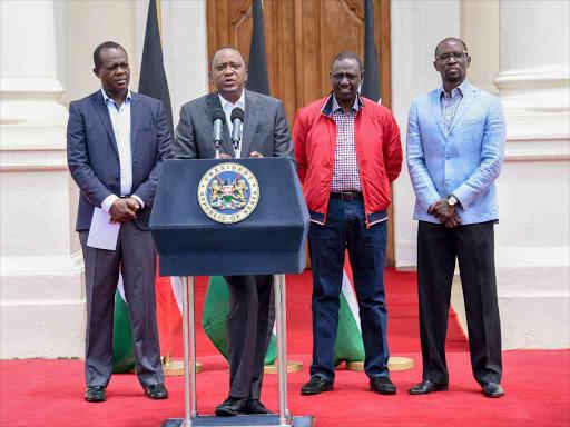 JP secretary general Raphael Tuju, President Uhuru Kenyatta and DP William Ruto address the media at State House, Nairobi.