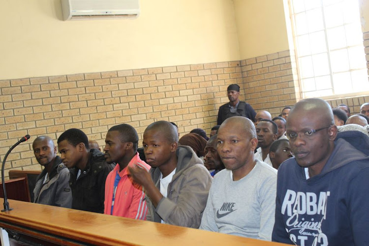 Mancoba Seven Angels Ministry members who were arrested in connection with the murder of five Ngcobo policemen appear in the Ngcobo Magistrate's Court on June 14 2018.
