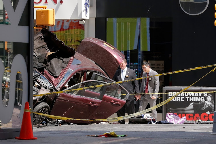 Police investigate the vehicle that drove through pedestrians in Times Square in New York, the US, on Thursday. Picture: REUTERS