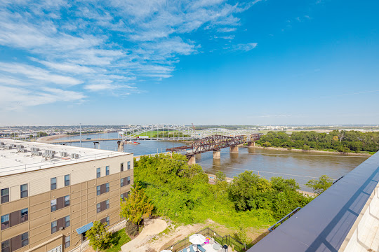 View of the Missouri River and bridge across it from Second + Delaware Apartments