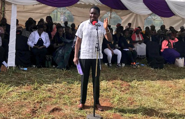 Agriculture CS Mwangi Kiunjuri addresses mourners during the burial of Batista Maina at Ntuugi, Meru county, on Monday. The late Batista maina's burial at Ntuugi, Meru County. Photo/Courtesy Kiunjuri addressing mourners
