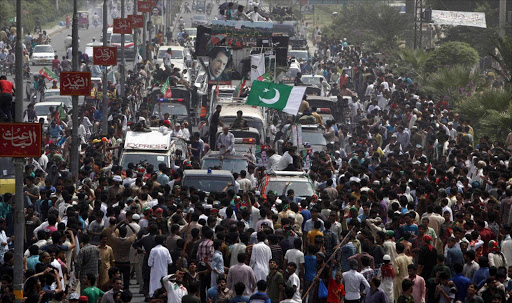 Supporters of cricketer-turned-opposition politician Imran Khan take part in the Freedom March in Gujranwala.