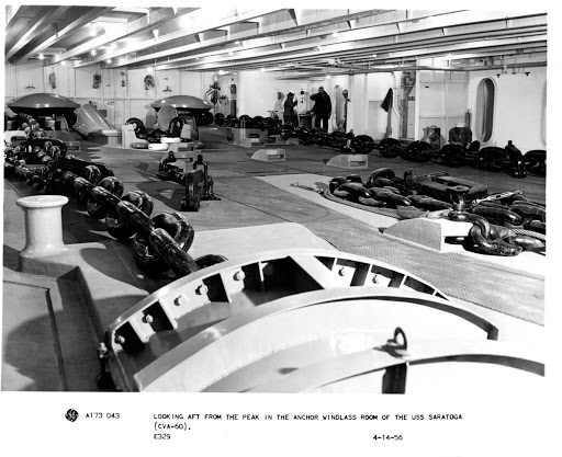 Looking aft from the peak in the anchor windlass room of the USS Saratoga, CVA-60