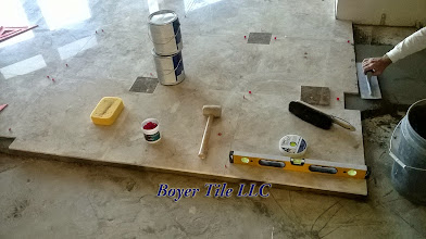 Photo: Tools of the trade. Note the custom inlay and its associated tile cut by my hand. Adding a single inlay involves lots of work. And, it must be perfect, every time.