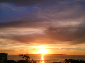 Photo: 伊江島見ながらサンセットタイム。空が雲がいい感じに焼けてきた。