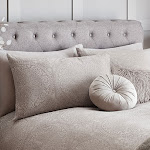 Cream bedding with matching pillows, pinwheel cushion and faux fur cushion
