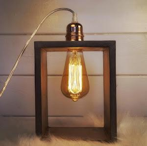 lampe à poser en béton de couleur taupe avec détail industriel