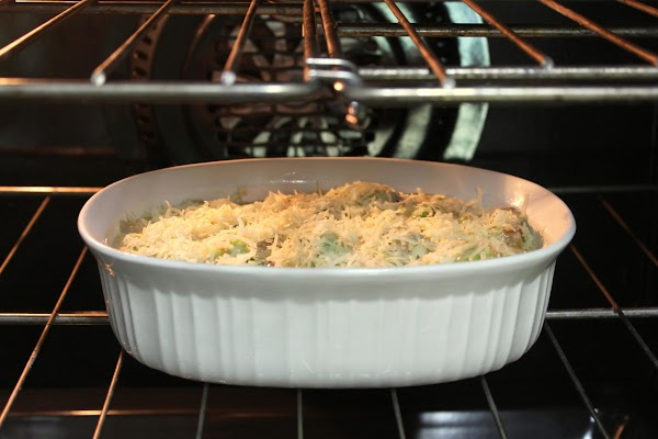 Pour into a casserole dish. Add remaining cheese and put pan in oven about...