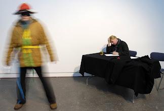 """Photo: 413.A. 176; """"Martwa natura z pisarzem Szkockim, Sardegnauno i pestka Ai Weiwei"""" /with Donna Rutherford as the Scottish writer (patrz App. 152 próba, 152, 157, 158, 160, 162); szklana butelka po Coca Coli (patrz App. 175); """"pestka"""" markowana –– zapomniałem wsiąść oryginał (patrz App. 170, 172, 173, 175); """"kostium II"""" (patrz App. 175)/; """"Polish Roots"""", """"New Territories 2011"""", International Festival of Live Art., Scotland, Glasgow 05.03.2011. (Film HD, zdjęcia) (C.)"""