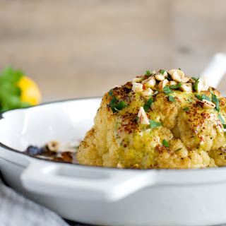Whole Roasted Cauliflower With Calabrian Chili Tahini Sauce [Vegan]