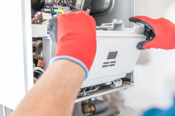 hvac technician installing furnace
