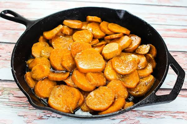 Old Fashioned Candied Sweet Potatoes In A Cast Iron Skillet.