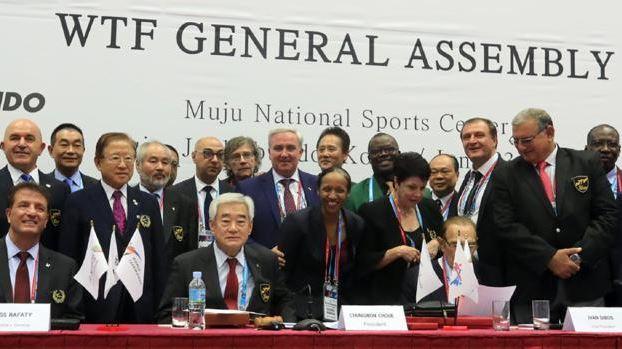 World Taekwondo president Choue Chung-won (centre) and delegates pose for a photo before the 2017 World Taekwondo championships in South Korea.