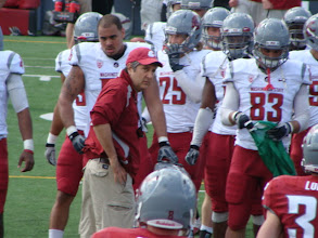 Photo: Coach Leach talking to his players on the sideline.
