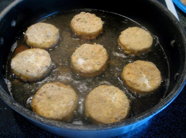 Dip patties into egg wash then flour then egg wash then bread crumbs. Pan...