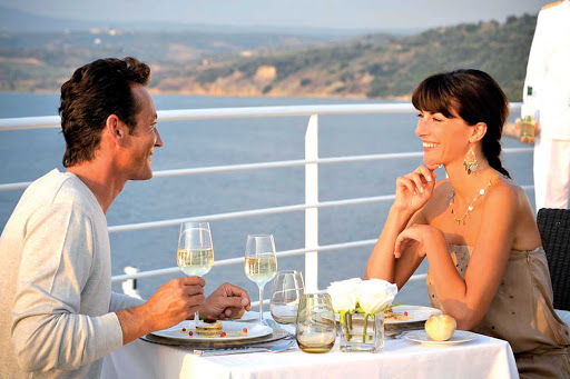 Enjoy exquisite foods and well paired wines when dining al fresco on a Ponant cruise.
