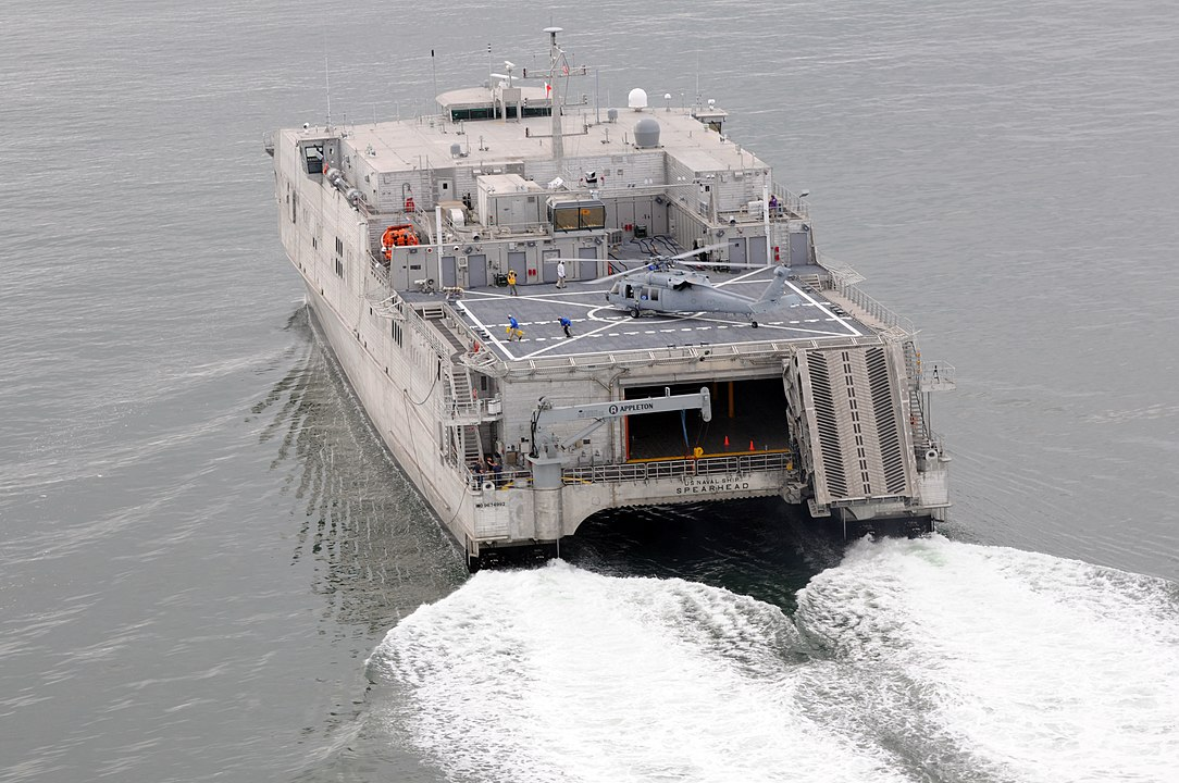 A photo of the rear of the USNS Spearhead - a military catamaran.