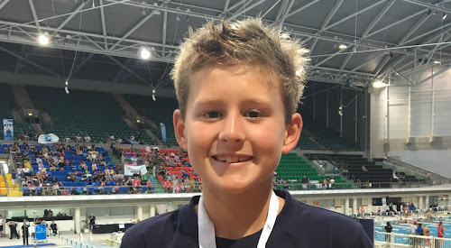 Angus Ciesiolka with his 11-years 100m backstroke silver medal.