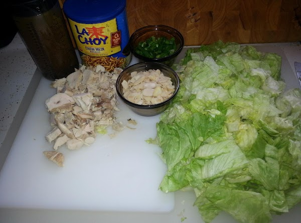 In a large bowl, toss together, lettuce, green onions, almonds, poppy seed, & chicken...