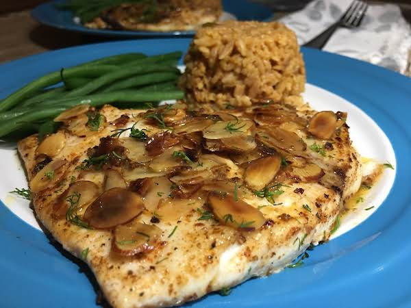 Sole With Green Beans And Rice On A Blue Plate.