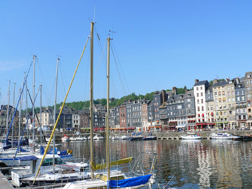 Packed with cultural sights, Honfleur harbor is located in an estuary where the Seine meets the English Channel.