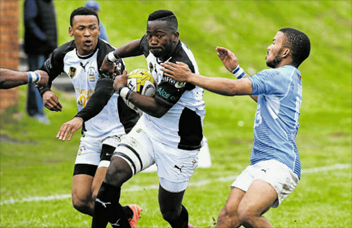 FULL THROTTLE: Old Boy's Siyamthanda Mgubo runs with the ball, while supported by teammate Foxy Ntleki, during their game against Progress Uitenhage at Old Boys Club at the weekend. Picture: ALAN EASON