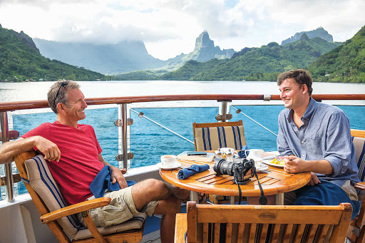 Relax on board after a day exploring tropical islands on your Lindblad expedition.