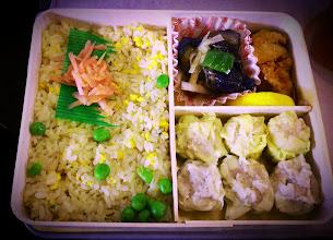 Photo: There are literally dozens of bento boxes to choose from at the train station before boarding a lengthy train ride. The other girls chose this Chinese food themed bento box: fried rice, mini shumai (dumplings), and an eggplant veggie stirfry.