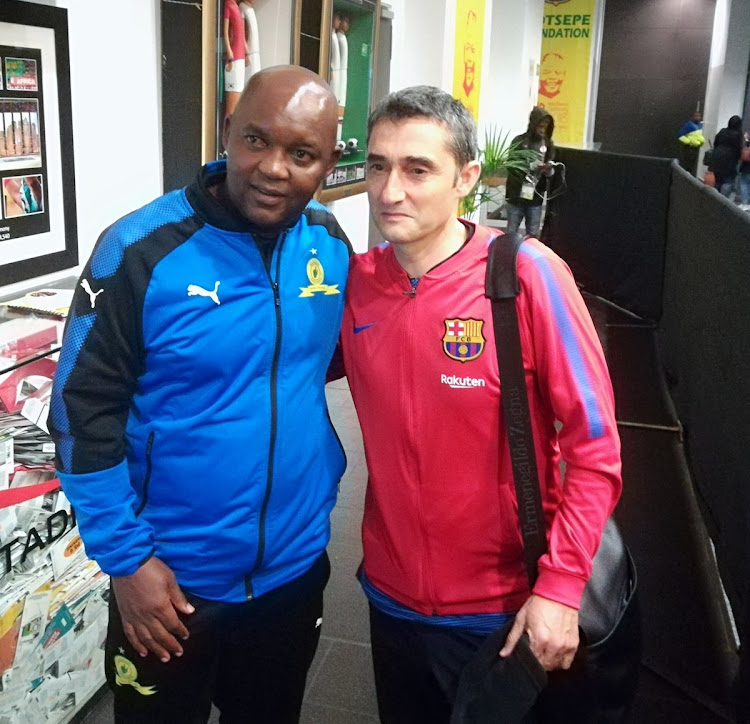 Mamelodi Sundowns head Pitso Mosimane with his FC Barcelona counterpart after the Nelson Mandela Centenary Cup between the two sides at FNB Stadium in Johannesburg on May 16 2018.