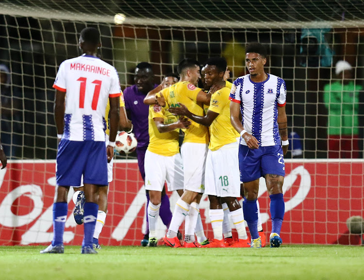 Mamelodi Sundowns players celebrate a goal as their Maritzburg United counterparts cut a dejected look during an Absa Premiership match at Harry Gwala Stadium on March 12 2019.