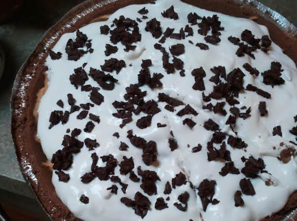 Easy Pumpkin Pie Topped With Sugar Free Cool Whip & Chocolate Shavings.