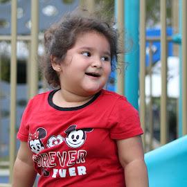 Having a good time...  by Mo Casanova Garza - Babies & Children Children Candids ( outside, slide, playing, park, smile )