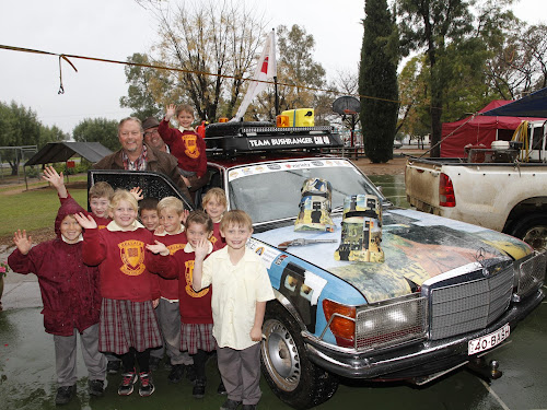 Bellata school pupils welcome the Variety Bash on Monday. From left, Tyler Stolzenberg, Lachlan Miller, Eryn Frost, Mac Morton, Jock Farr, Audrey Cooper, Chloe Gillogly, Hanley Budden, with Flynn McPherson, back, and Bashers John Dennis (Wahroonga) and Lachlan McNeill (Pymble).