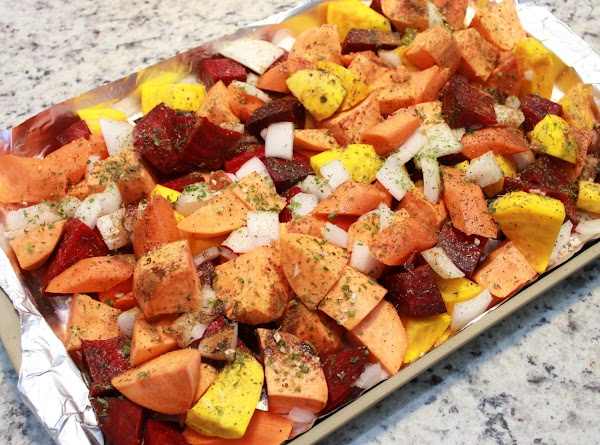 Place season veggies on to baking pan and spread them out into a single...