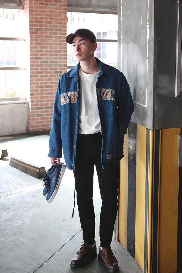 boy wearing a blue oversized hoodie over a white t shirt and black pants