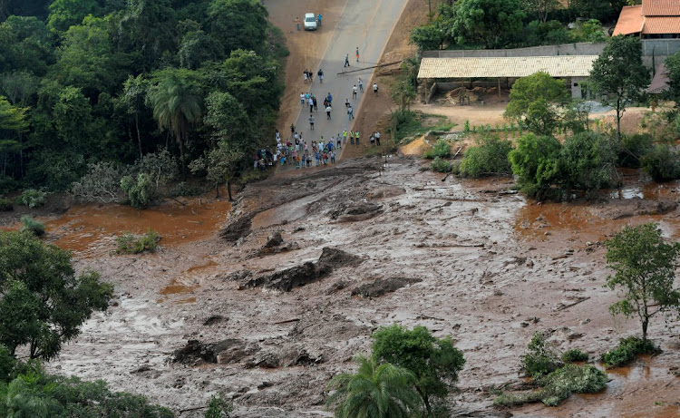 Residents watch as mud flows from a burst dam owned by Brazilian miner Vale, in Brumadinho, Brazil, January 25 2019. Picture: REUTERS/ WASHINGTON ALVES