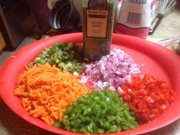Add in all the veggies, chopped chive and stir until well mixed together.