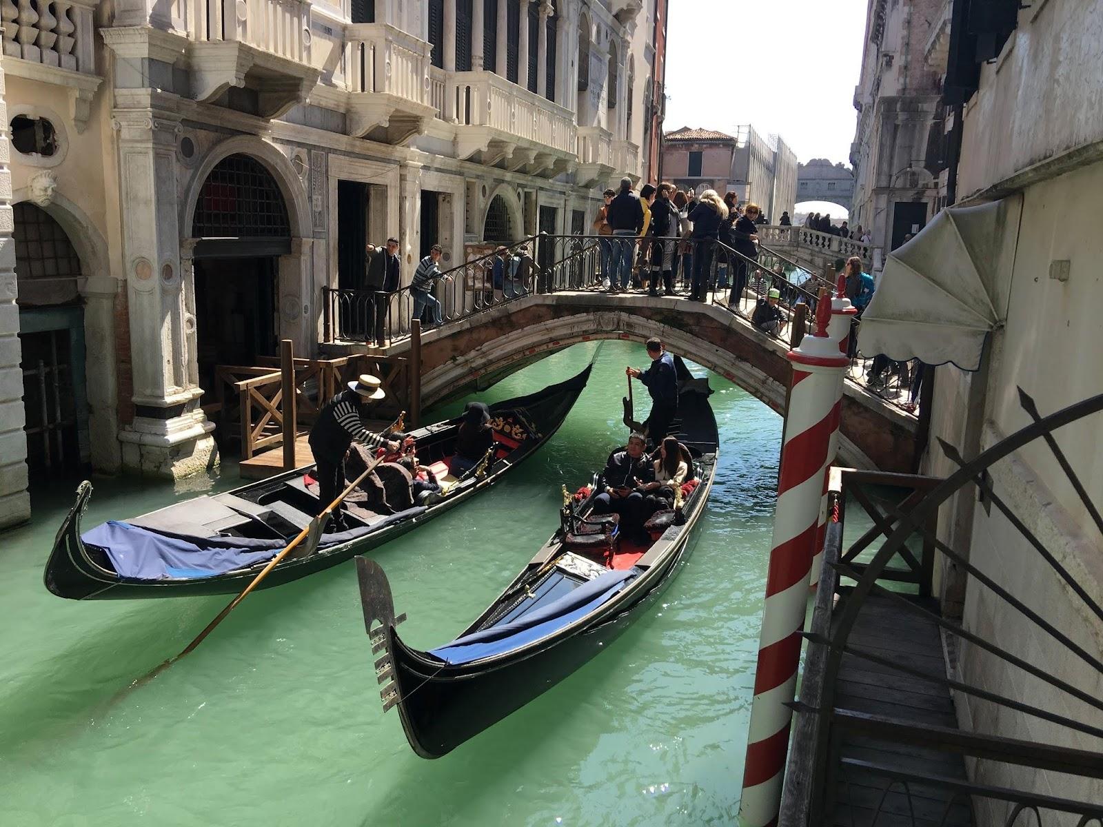gondolas in a canal in venice
