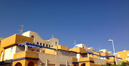 Photo: Blue sky and Milenio rooftops