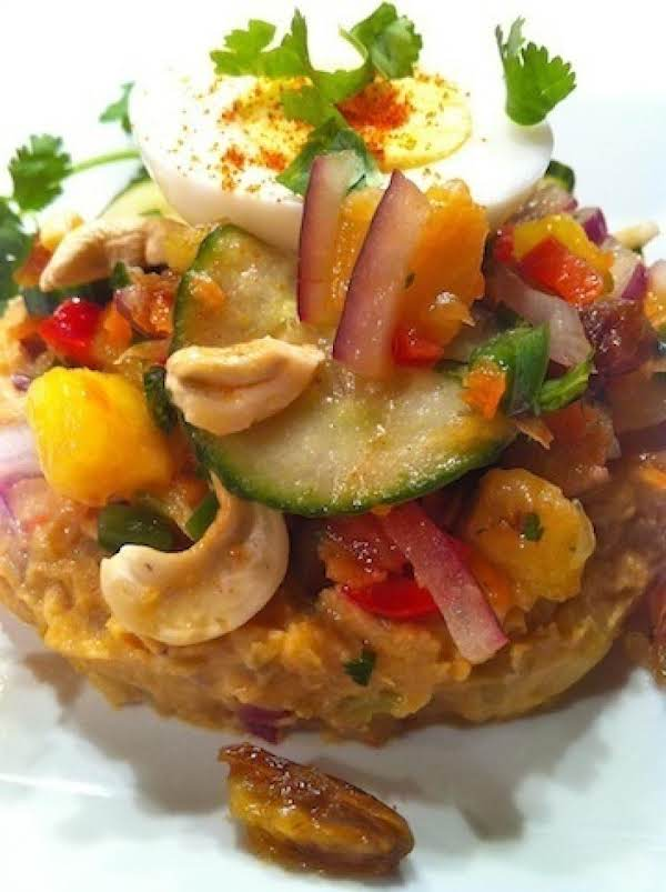 Japanese Sweet Potato Salad Stacked With A Tropical Date Mix And Topped With Hard Boiled Egg.