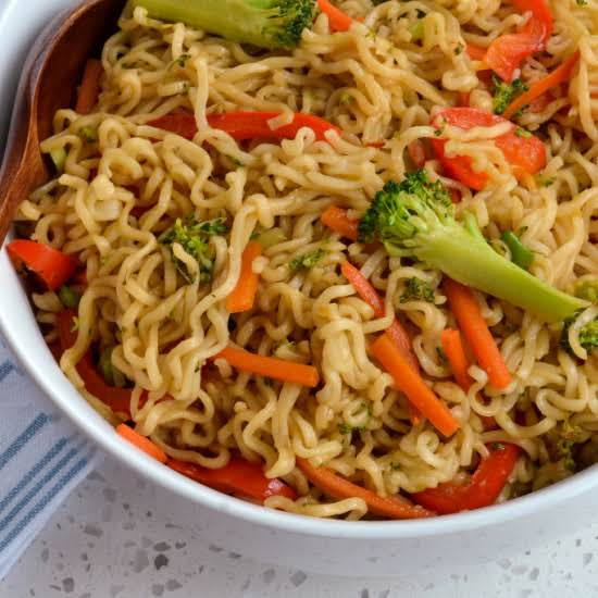 A Quick And Easy Ramen Stir Fry With Fresh Vegetables And A Six Ingredient Spicy Sweet Asian Sauce. It Is Always A Huge Hit With Family And Friends And On The Table In Less Than Twenty Minutes.