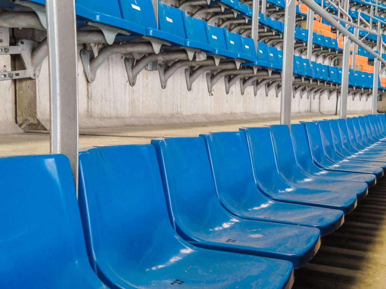 A close up of the seats where fans cheer on their team
