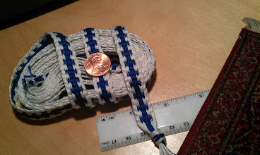 Photo: Inkle-woven, about 5 yds long, 0.5inch wide, blue & white embattled, cotton trim.
